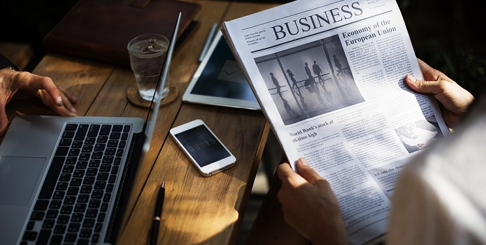 financial news, reading newspaper
