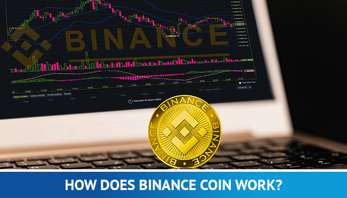 binance coin in front of a laptop with chart
